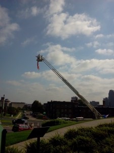 Bucket truck with American flag at the funeral.